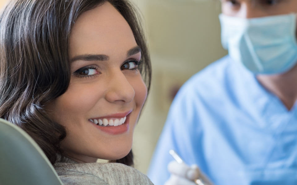 woman in dentist office smiling