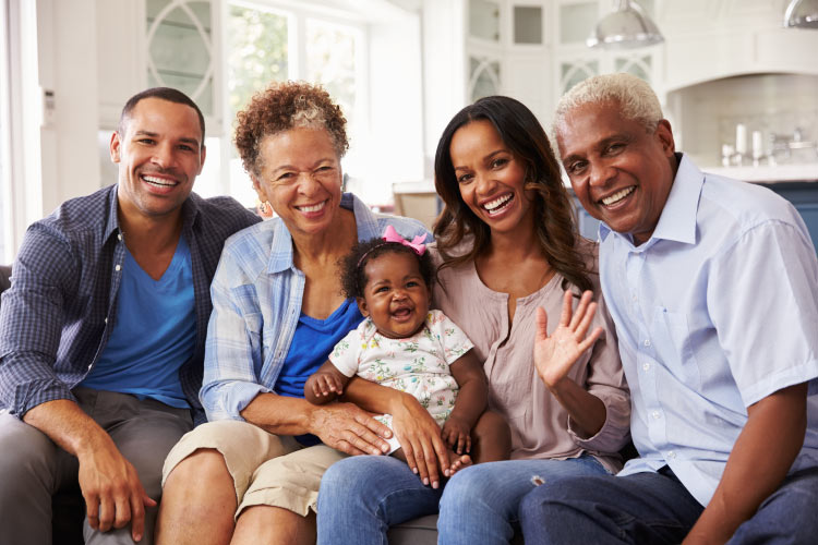 A multigenerational family of a mom, dad, grandma, grandpa, and granddaughter