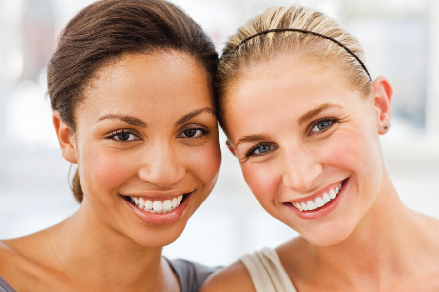 Two women smile after professional teeth whitening in Westerville, OH, at Sean Abidin, DDS & Vanessa Cao, DDS