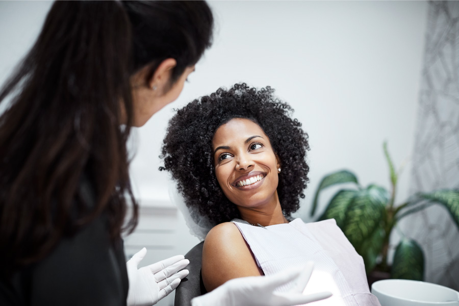 Curly-haired woman smiles after finding a great family dentist in Westerville, OH